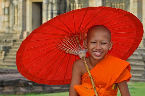 novice monk at phimai ruins in thailand