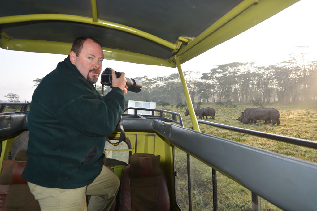 Ray photographing the rhinos from the back of our landcruiser.