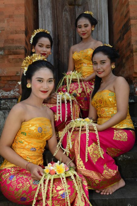 Girls with temple offerings