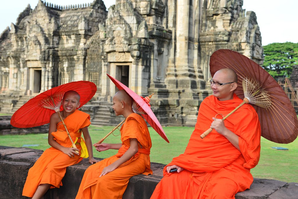 Head Monk and novice monks at Phimai ruins