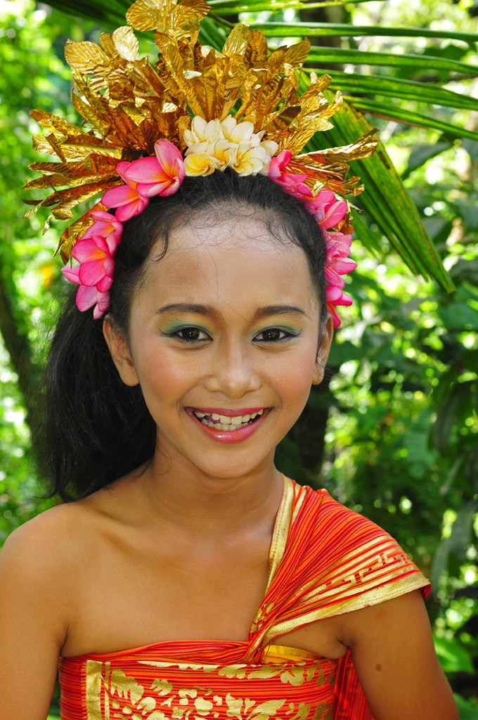 Local Bali girl in traditional costume