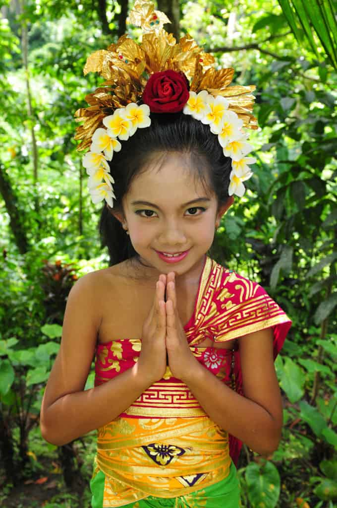 Local girl in traditional Bali dress