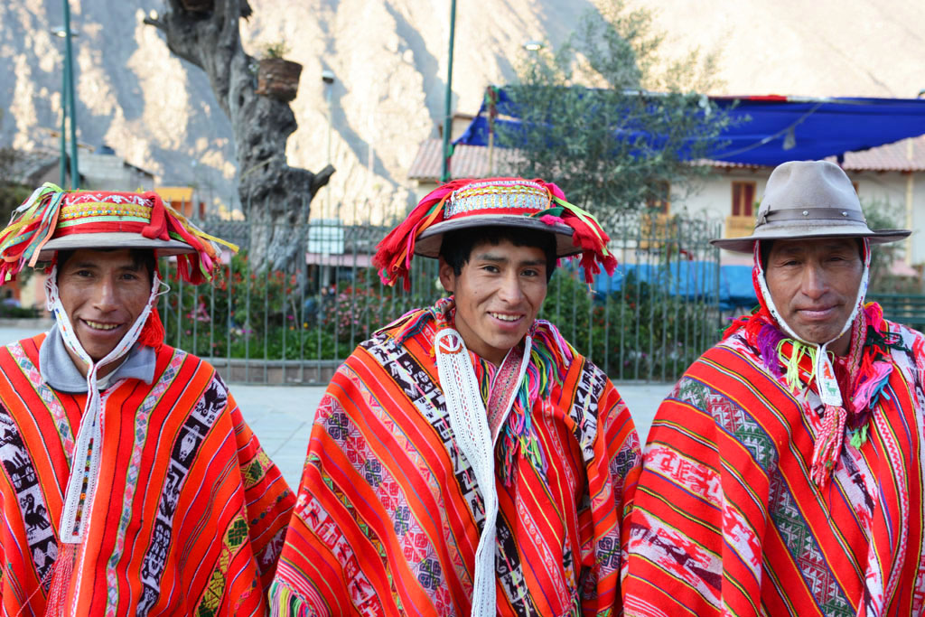locals in the main square at ollantaytambo