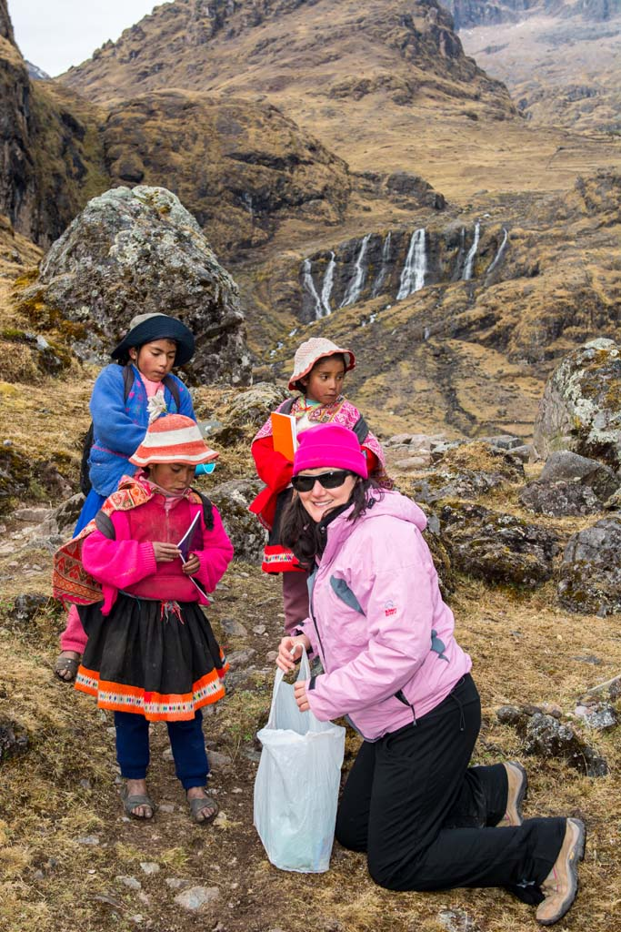 Sue handing our books to the children on Lares trek